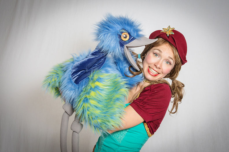 Drea with her kids party bird puppet